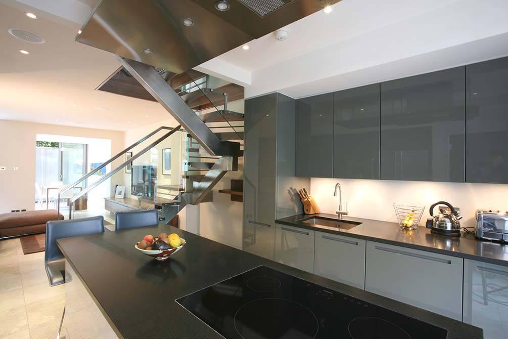 abington-bespoke-staircase-glass-balustrade-stainless-steel-handrail