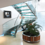 glass staircase next to plant