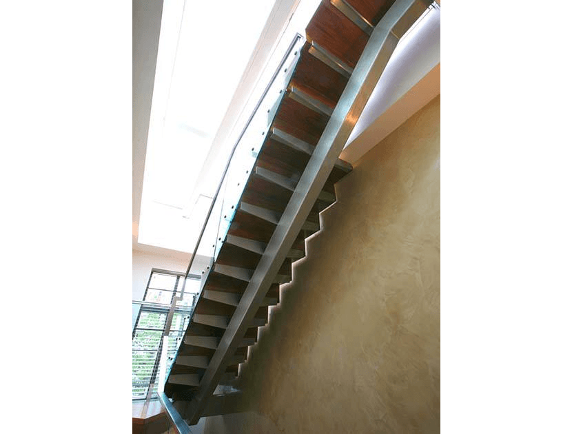 Underneath straight staircase