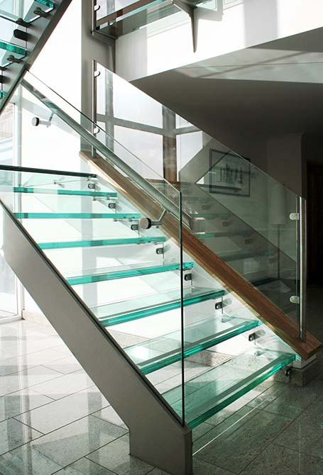 buttery modern glass staircase canal architectural
