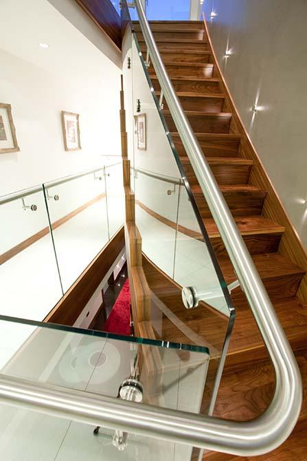 Cliff timber staircase glass balustrade