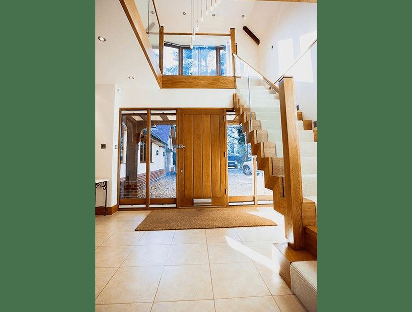 Zig Zag staircase next to wooden door