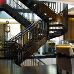 Helical staircase with leather handrail