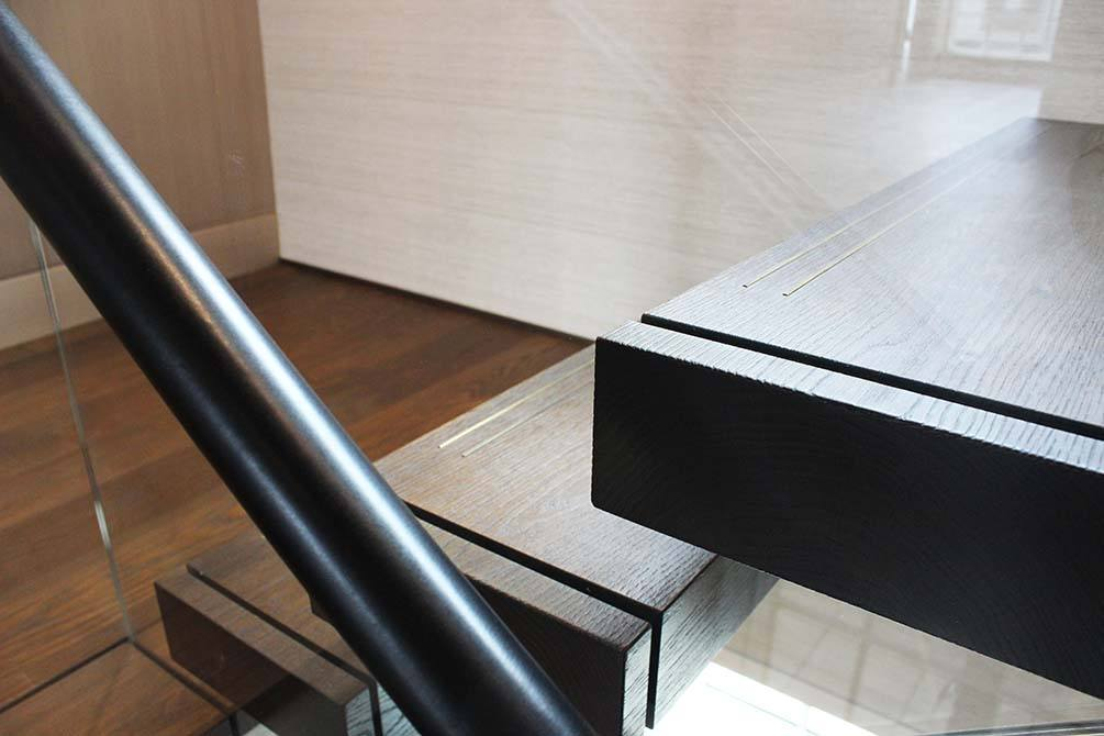 cantilever-staircase-brown-leather-handrail-separa
