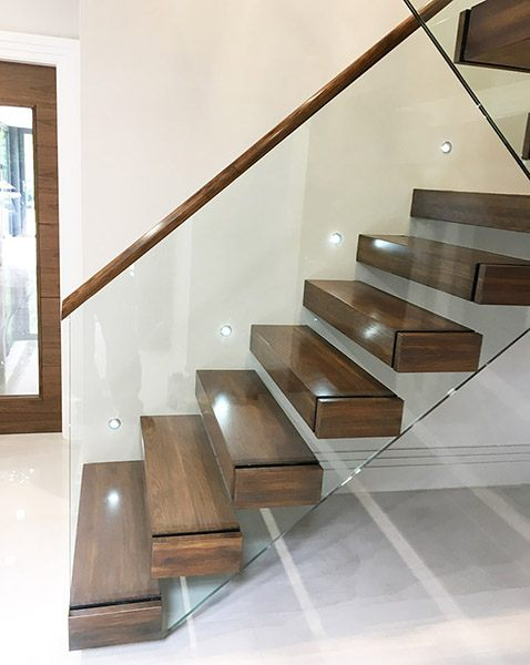Walnut-treads-open-riser-cantilever-floating-staircase