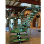 Glass central spine staircases