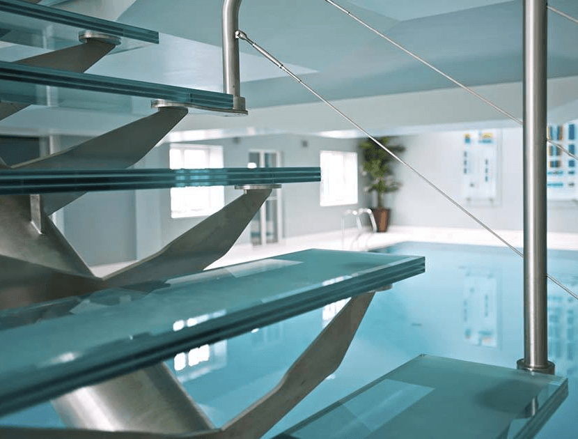 Centre spine stairs next to swimming pool