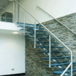 Glass central spine staircase